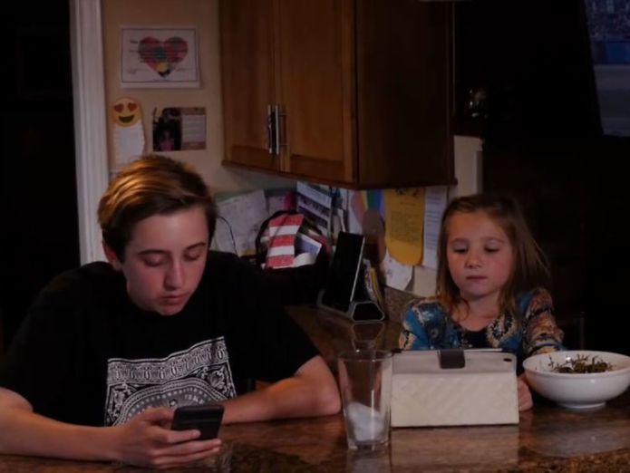Michael and Sophia Koch can barely eat their meals without getting a technology fix