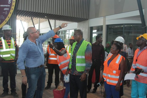 Mr. Gerber explains a point about the architecture to journalists as Chairman Kofi Sekyere looks on during the facility tour by Kumasi media practitioners