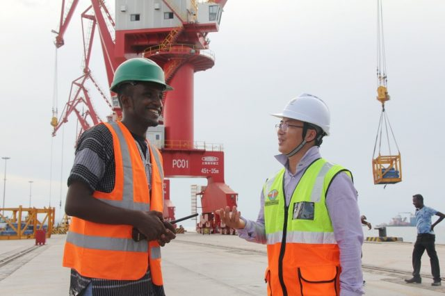 Chinese and Djiboutian administrative staff exchange views on a new dock built by China Merchants Group Limited (CGM) in the port in western suburb of Djibouti. The multi-functional Doraleh dock has greatly improved the competence of the port. (Photo by Li Zhiwei from People's Daily)