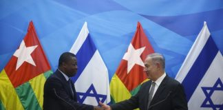 Israeli Prime Minister Benjamin Netanyahu, right, shakes hands during a joint statements with Togo's President Faure Gnassingbe in Jerusalem on Wednesday, Aug. 10, 2016. (Ronen Zvulun/pool photo via AP)