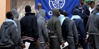 This week's flight from Libya was the seventh since January 2017 organized by IOM for Guinean migrants from Libya with a total of 859 migrants assisted so far. Above is a photo of Guinean migrants assisted by IOM last August. File photo: UN Migration Agency (IOM) 2017