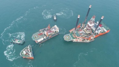 Oil drilling platform Shengli No.4 is in the midst of shipment at the outer anchorage of a port in Yantai, east China's Shandong province, Feb. 8, 2018. The Shengli No. 4 and the New Shengli No.1 will be sent to Nigeria for oil exploration services. (Photo by Chu Yang from CFP)