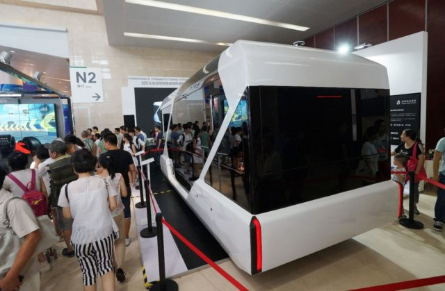 An unmanned bus is displayed during the World Intelligence Congress in Tianjin on July 1, 2017. (Photo by Li Shengli from People's Daily Online)