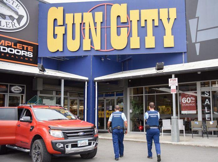 Police officers patrol near a gun market named