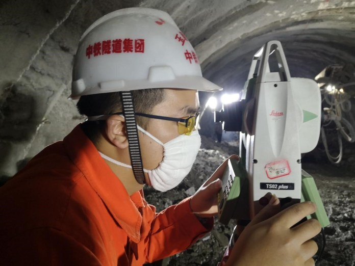 An engineer surveys a tunnel along the Yuxi-Mohan section of China-Laos Railway. Photo by Ye Chuanzeng, Zhang Weiming, People's Daily