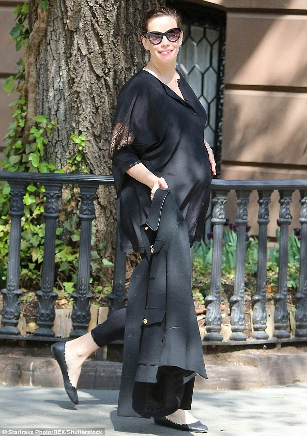 She's glowing:Liv Tyler, who's expecting her third child later this year, proudly showed off her growing belly in New York on Monday