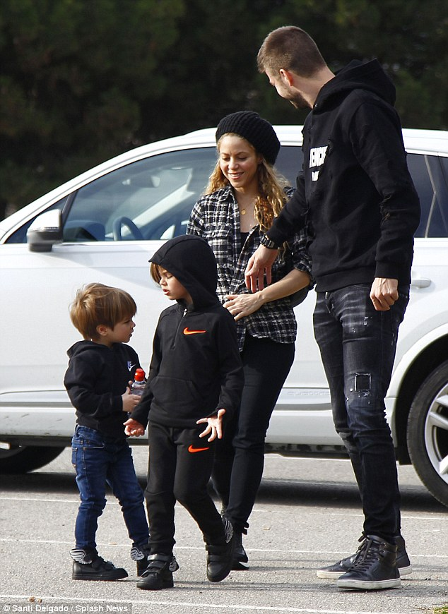 Chilled family outing: Shakira and her Spanish pro soccer star partner Gerard Pique took their sons, Milan, four, and Sasha, two, to a Disney On Ice show in Barcelona, Spain, on Monday