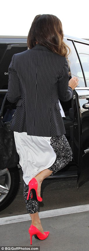 Getting a leg up: Kate kicked up her heels even before the plane took off
