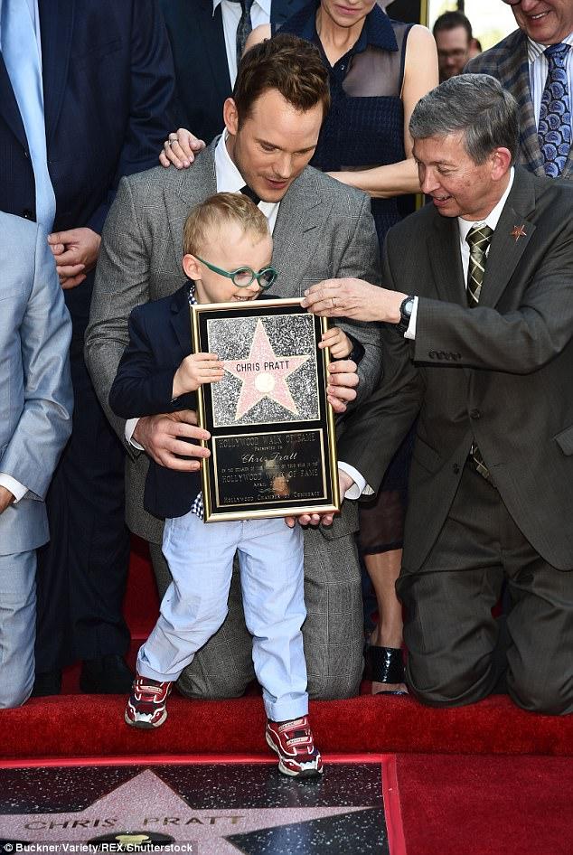 Little stud! Pratt's son held up the Walk Of Fame frame
