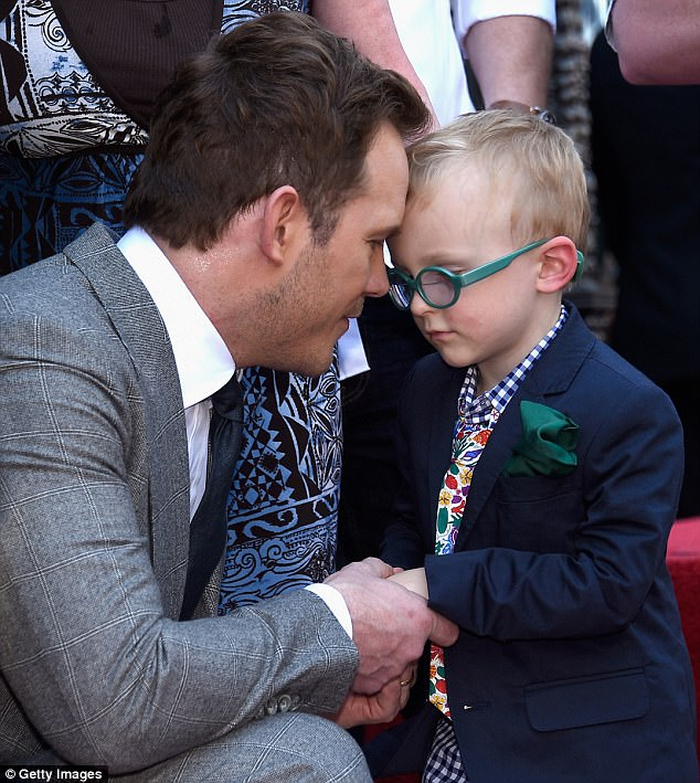 Daddy's boy! Pratt's son looked adorable in his glasses and suit jacket