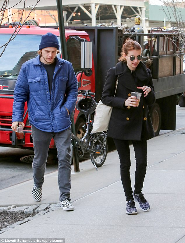 Casual couple: Sporting ski cap, blue parka and checkered Vans, Evan may have met his match with Emma, dressed warm but informal in black coat, black leggings, and sunglasses by Steven Alan Optical