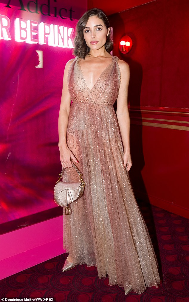 Golden girl:Olivia enjoyed a stylish tour of Europe in recent weeks and was spotted attending one of the many fashion events in Paris and Milan; seen at the Dior show on Feb. 25