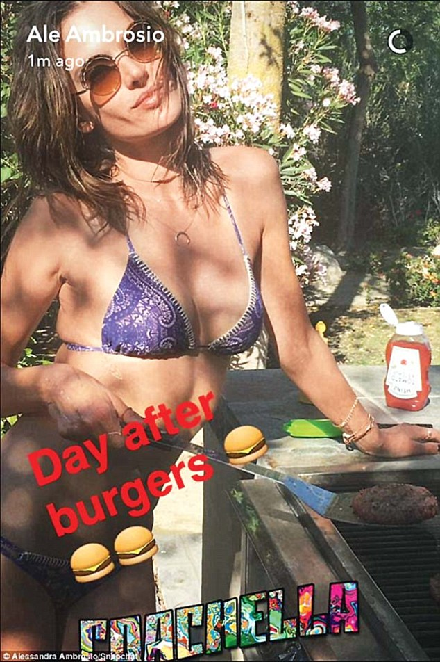 Festival food: Over the weekend the bikini-clad brunette shared a shot flipping burgers on the grill. But we see no evidence of such a thing on her flawless figure