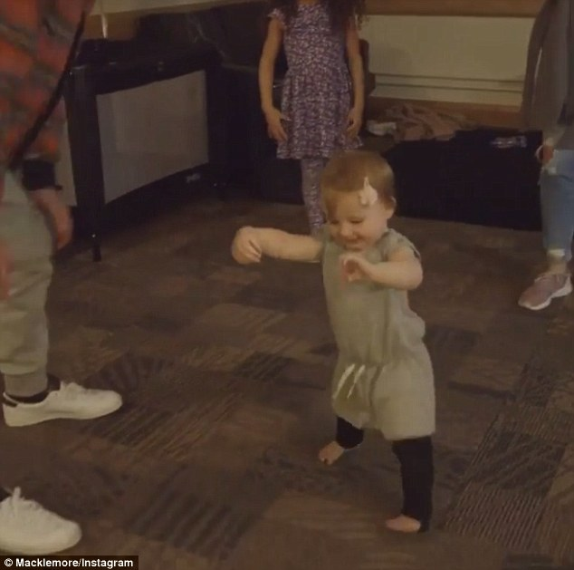 She's got this! The mother-of-one rushes to her daughter's side, but is beaten by the toddler's successful ability to stand on her her own