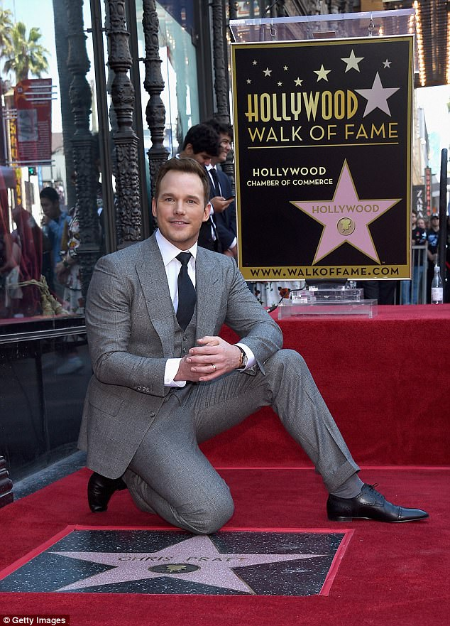Modest man: Pratt looked pleased and humble as he knelt next to his star