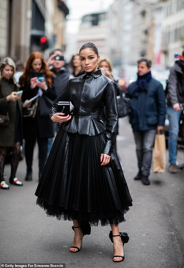 Strike a pose: She strutted her stuff in black leather and tulle outside of the Ermanno Scervino show at Milan Fashion Week on Feb. 23