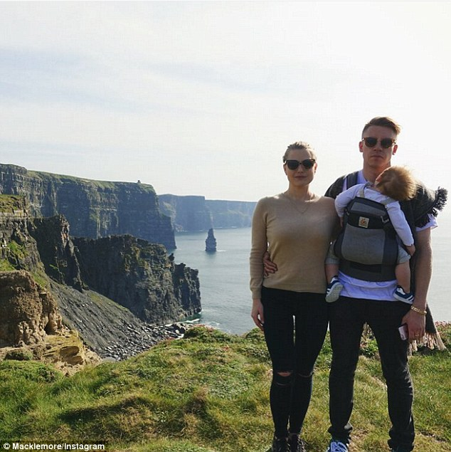 Travelling together: The family of three is pictured at the Cliffs of Moher in Ireland on Thursday