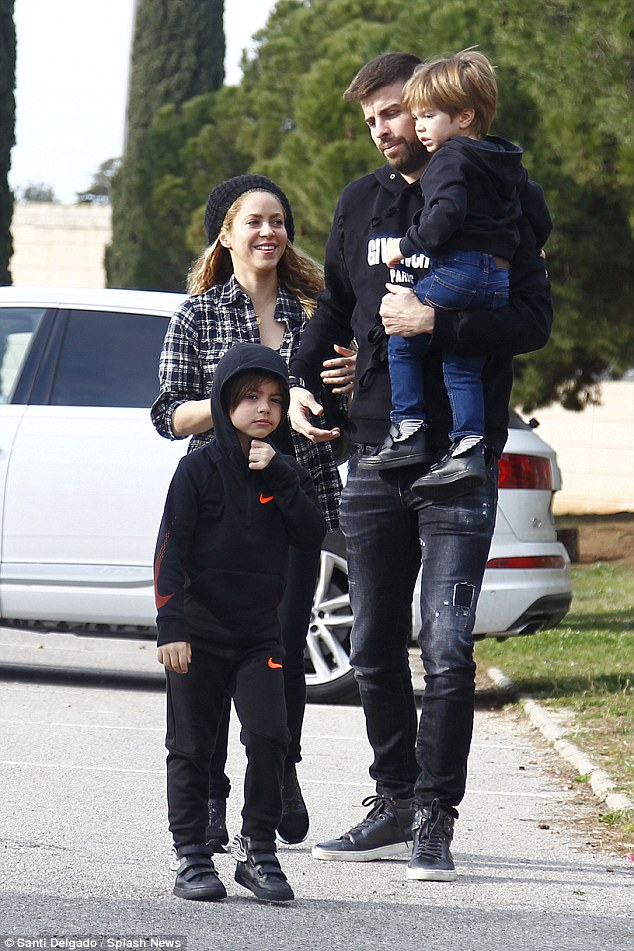 So in love: Shakira, 41, held her hunky beau's arm while the 31-year-old carried Sasha with Milan walking in front