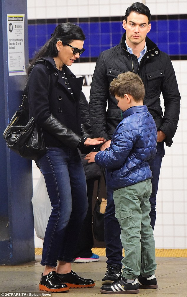 Underground crew: Julianna Margulies hops on the subway as she spends a family day with husband Keith Lieberthal and their son in New York on Saturday