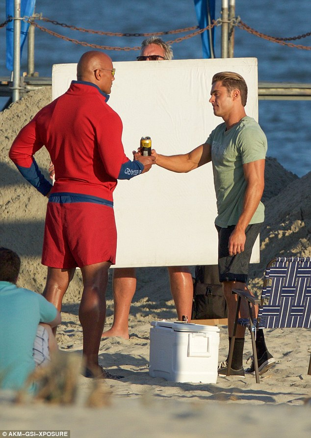 Cheers: Dwayne Johnson and Zac Efron filmed a scene in which their characters exchange words over the cooler