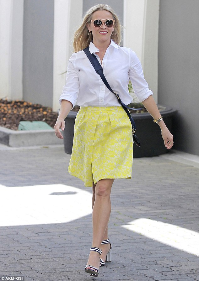 Mellow yellow: On Thursday, Reese wore the $225 Harpeth Jacquard Mid-Length Skirt from her line paired with a white button up blouse and chunky striped heels as she left her office in Beverly Hills