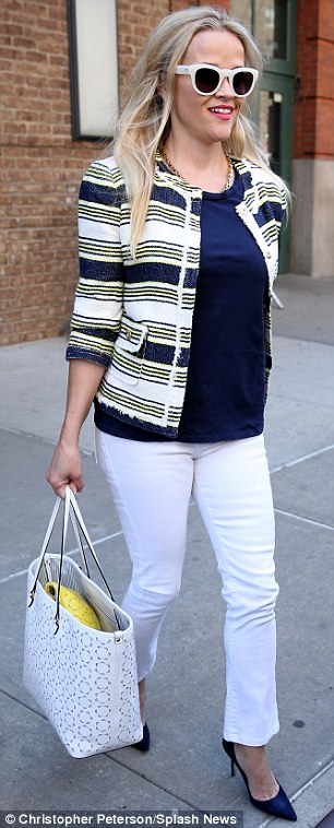 The perfect promo: The blonde's dark blue blue T-shirt and matching high-heeled pumps didn't appear to be from Draper James but her capacious white bag certainly was. The Peabody perforated tote retails for $250