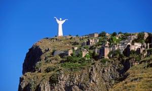 The white Redeemer statue by Bruno Innocenti above Maratea.