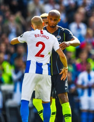 Kompany congratulates Bruno as he is substituted and retires from the game.
