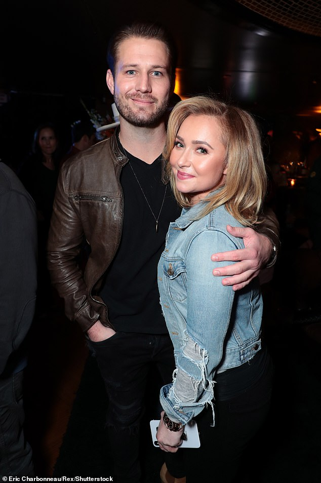 Trouble: Hayden Panettiere's boyfriend Brian Hickerson faces felon charges stemming from a physical altercation with the actress in May, according to RadarOnline; seen in December