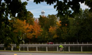 A cyclist is seen along the Rideau Canal near the Glebe in Ottawa, Canada, October 5, 2018. (Cole Burston)