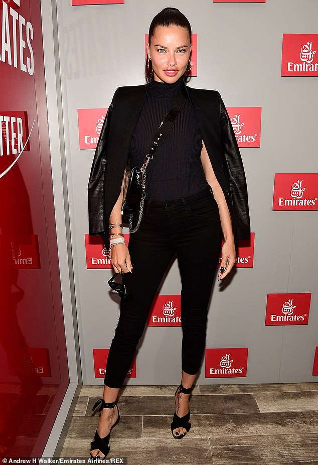 Back in black: Adriana Lima, 38, showed off a striking all-black look on Friday as she caught some Tennis and visited the Emirates Airlines suite in New York City