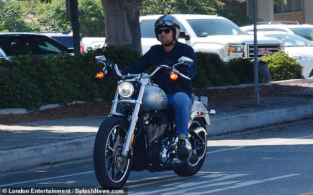 Cool: Ewan McGregor looked effortlessly cool as he zoomed around Brentwood, California on his motorbike on Wednesday