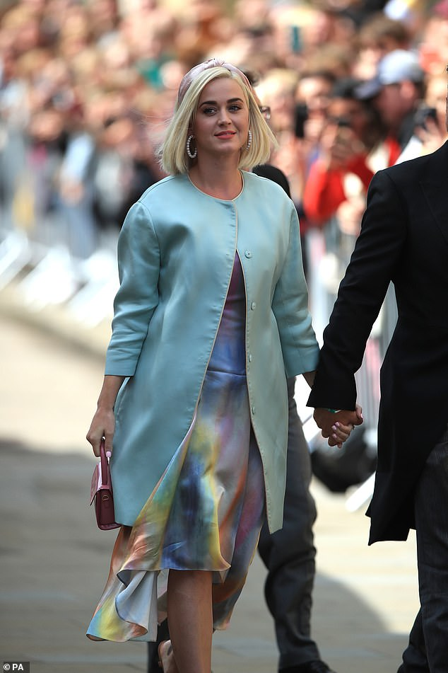 A vision: Katy Perry arrived in a stunning ensemble alongside Orlando Bloom for the wedding of Ellie Goulding and Caspar Jopling at York Minster Cathedral on Saturday