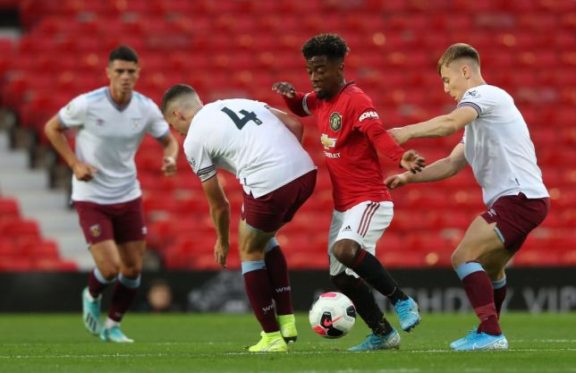 Angel Gomes dribbles the ball for Manchester United U23s against West Ham