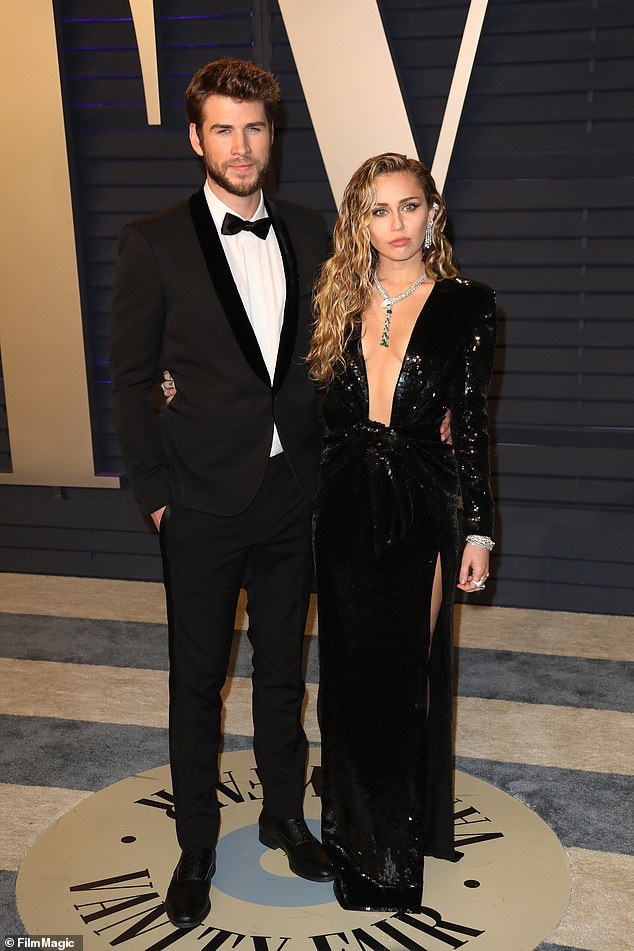 Throwback: Her estranged husband Liam Hemsworth filed for divorce on Wednesday in Los Angeles. And Miley Cyrus is 'a bit disappointed' that he filed, according to People; pictured February 24, 2019 in Beverly Hills at the Vanity Fair Oscar Party