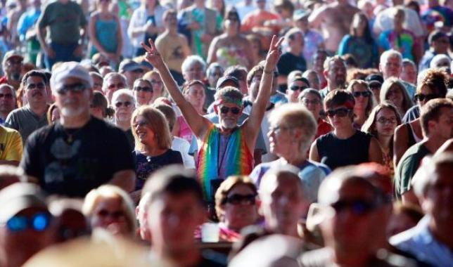 A fan flashes the peace sign at the 40th anniversary of the Woodstock music festival