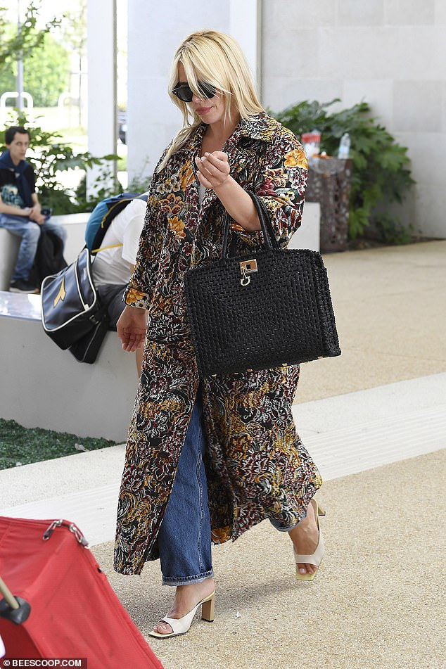 Stylish:The Mansfield Park star carried her belongings in an oversized black woven handbag
