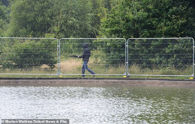 Dogs went swimming in the infected water while out for a walk and died just hours later. News of the UK dog deaths comes just days after three dogs suffer seizures and died from the same condition. Fences have now been put up to prevent swimming (pictured)