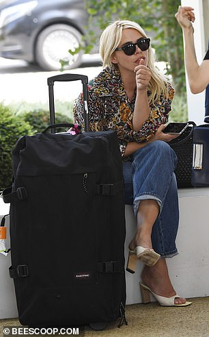 Chilling out: Billie sat outside her hotel while waiting for her driver to arrive