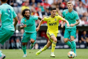 Ferdi Kadioglu of Fenerbahce surges past Real Madrid's Marcelo during their Audi Cup match in July 2019.