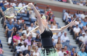 Caroline Wozniacki hits a return to Bianca Andreescu.