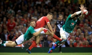 Wales' Jarrod Evans clears the ball.