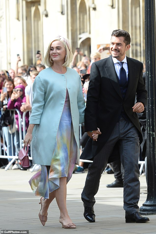 Gorgeous couple:The Fireworks singer, 34, turned heads in a duck egg blue dress coat over a watercolour print silk number, while her actor beau, 42, looked dapper in his morning suit