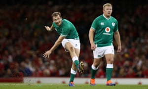 Ireland fly half Jack Carty kicks the first points of the game.