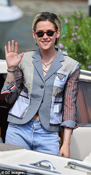 Gleeful: The Twilight actress appeared in good spirits for her outing, as she happily waved to crowds before making her way to her next destination