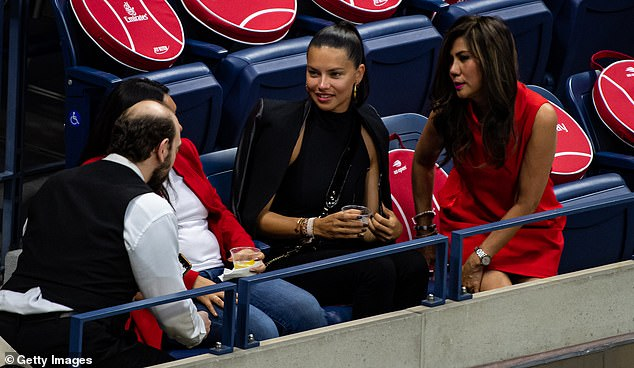 Functional: Adriana kept her raven tresses pulled back casually in a tight ponytail, and her large gold hoop earrings framed her impeccably made-up face