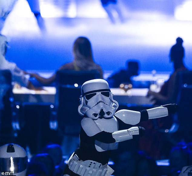 Playful: The mini-Trooper led Simon to ask whether his son Eric, five, had secretly joined the troupe