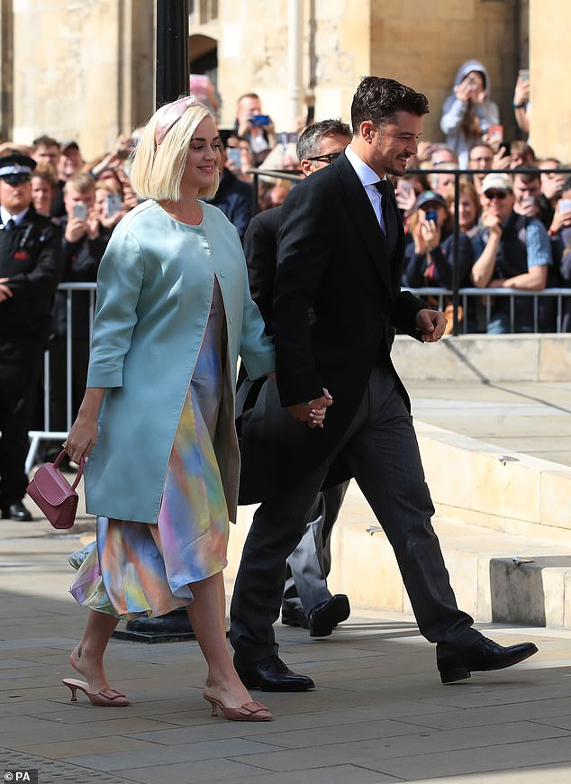 Big day: Katy and Orlando appeared in high spirits at the wedding, as they too prepare to tie the knot in the near future