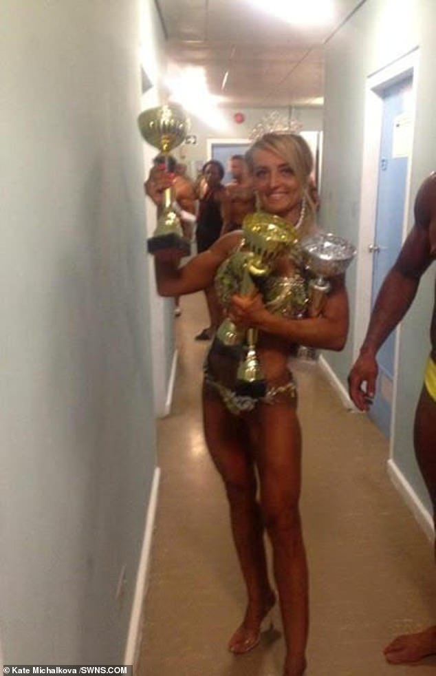Ms Michalkova said her implants looked 'amazing' and gave her the confidence to enter and win a number of fitness competitions, some of which she won (pictured)