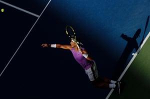Rafael Nadal serves.